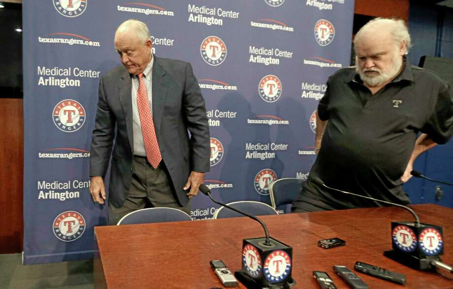 Texas Rangers CEO and president Nolan Ryan, left, and team owner Bob Simpson stand up after a news conference announcing Ryan's retirement from the baseball team Thursday in Arlington, Texas. Ryan is retiring at the end of the month after six seasons as CEO. Photo: LM Otero — The Associated Press  / AP