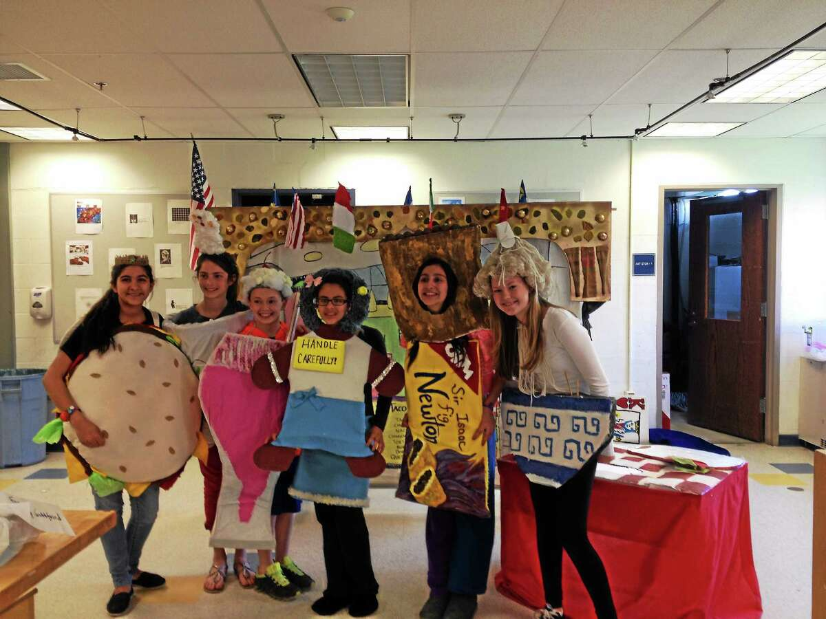 The Har-Bur Middle School Odyssey of the Mind Team: (from left to right) Sasha Ahmed, Lauren Alvarez, Aiden O'Conner, Lucy Gottfried, Alisha Petrosky, and Tanya Weingart in their costumes from the food court section of their play.