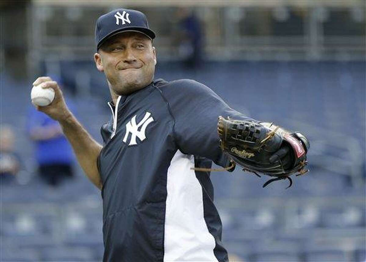 New York Yankees shortstop Derek Jeter, who is on the disabled list, throws soft toss before an interleague baseball game at Yankee Stadium in New York, Thursday, May 30, 2013. (AP Photo/Kathy Willens)