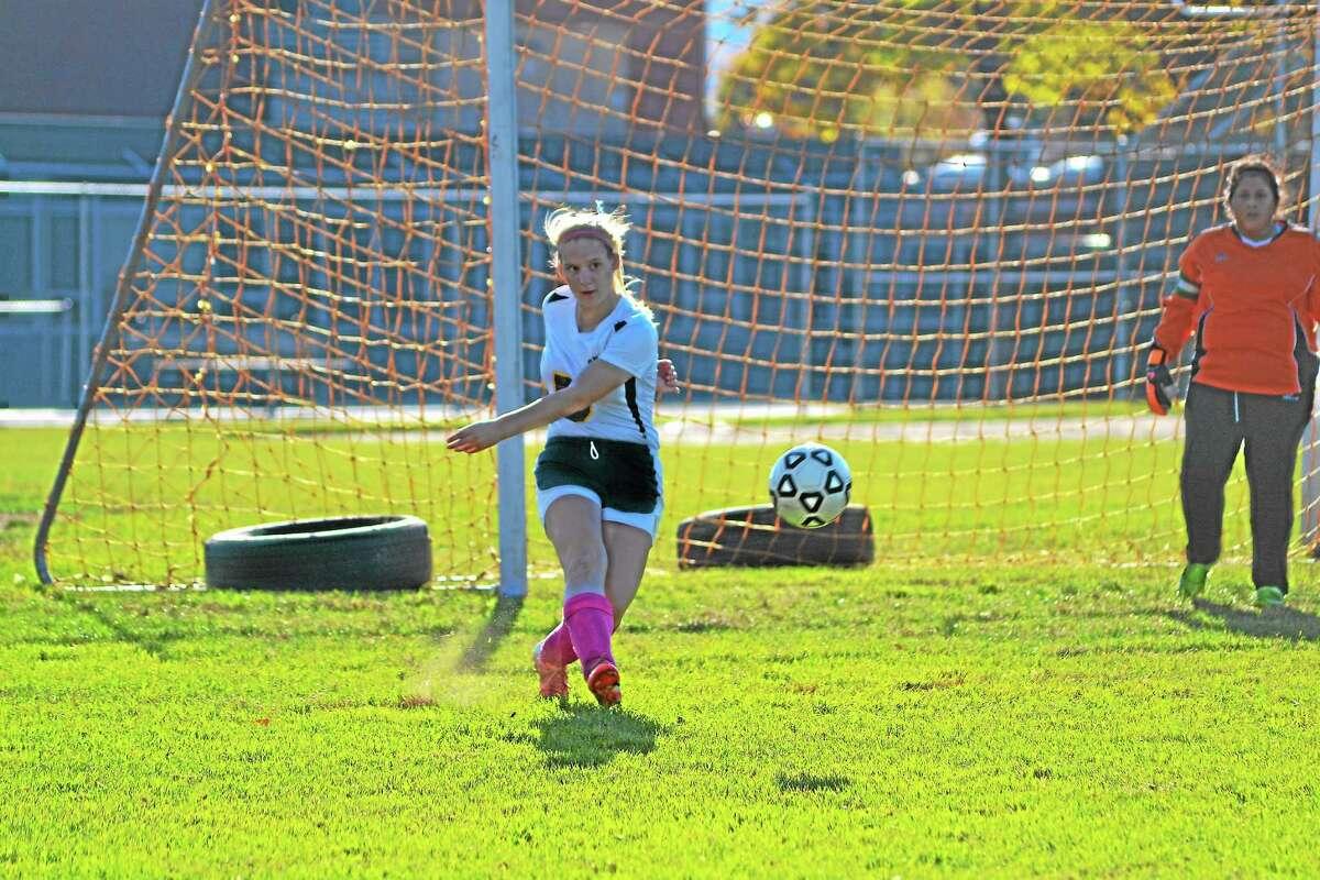 Wolcott Tech's Cecilia Hill kicks the ball up field. Sacred Heart won 7-0.