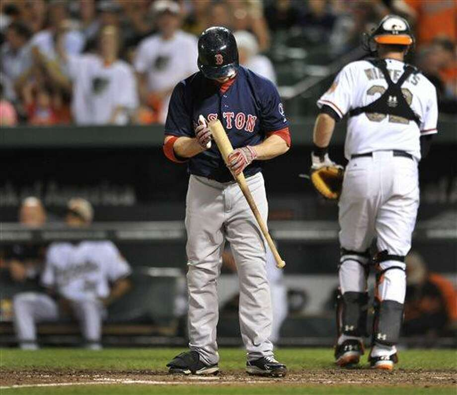 Boston Red Sox's Daniel Nava reacts after striking out against the Baltimore Orioles in the sixth inning of a baseball game, Friday, June 14, 2013, in Baltimore. The Orioles won 2-0. (AP Photo/Gail Burton) Photo: AP / FR4095 AP