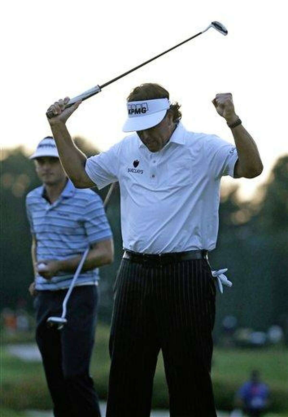 Phil Mickelson reacts after his birdie putt on the 18th hole during the second round of the U.S. Open golf tournament at Merion Golf Club, Friday, June 14, 2013, in Ardmore, Pa. (AP Photo/Morry Gash)