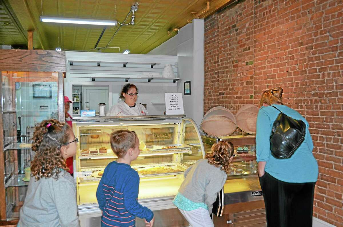 Young customers excited for an afterschool treat. Left to right - Hailey Czyz, Patrick Hinman, Lea Czyz and Heather Hinman. Heather Hinman stopped in with her kids and her friend Michelle Czyz and her kids to check out the new bakery Wednesday afternoon.