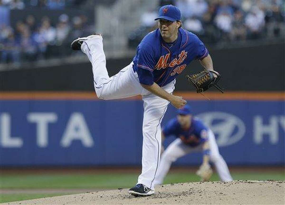 New York Mets' Shaun Marcum delivers a pitch during the first inning of a baseball game against the Chicago Cubs Friday, June 14, 2013, in New York. (AP Photo/Frank Franklin II)