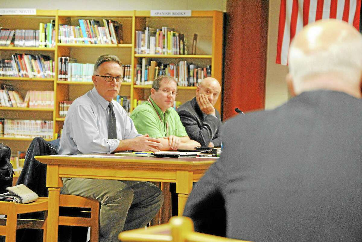 Paul Cavagnero, left, hears the conclusion of an investigation into his actions during a school improvement committee meeting, Sept. 11. D. Charles Stohler from Carmody & Torrance in Waterbury presents the investigation's findings.