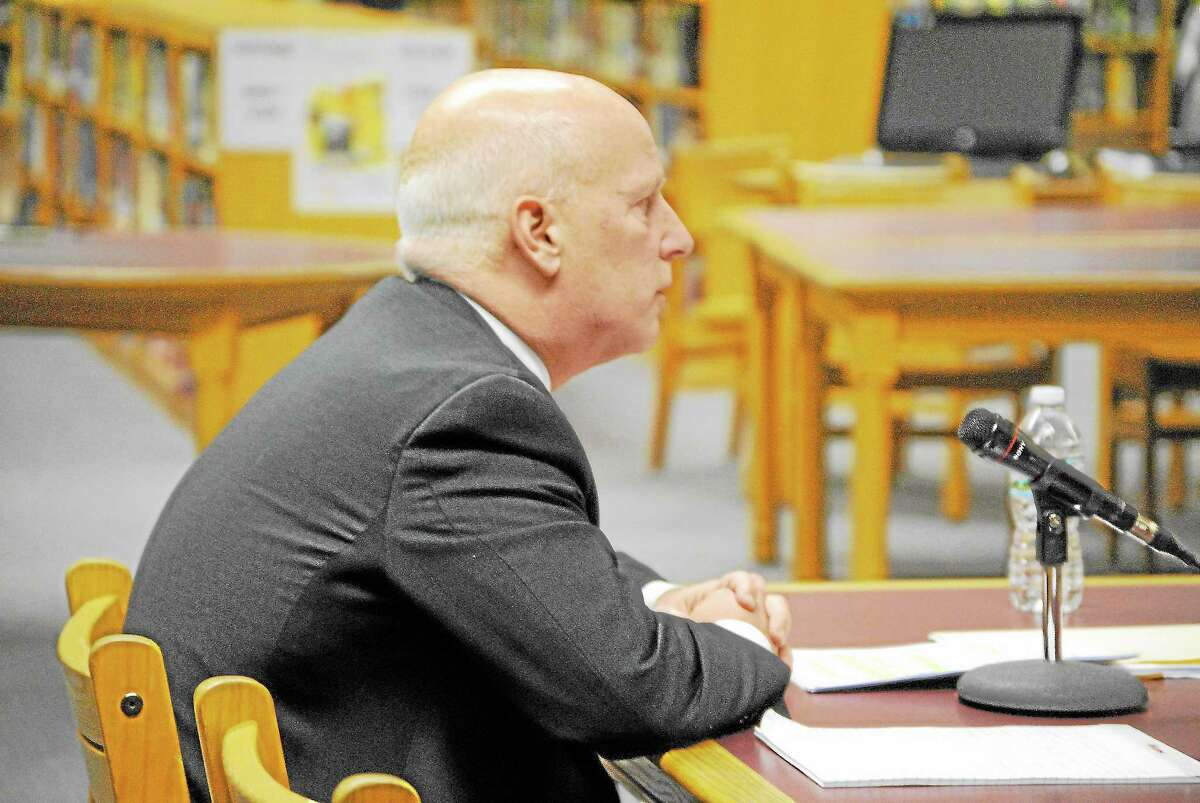 D. Charles Stohler of Waterbury-based Carmody & Torrance presents the findings of an investigation into Paul Cavagnero's actions at a Sept. 11 school improvement committee meeting.