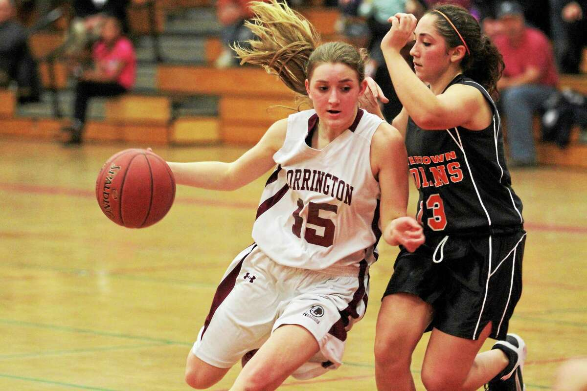 Torrington's Caroline Teti drives to the lane in the Red Raiders (8-2) come from behind 40-39 win against Watertown (7-2). Teti scored eight points in the win. This match up was the first time the two schools have met since the Red Raiders upset the Warriors in the NVL Tournament Title game last season when the Red Raiders won 40-38.
