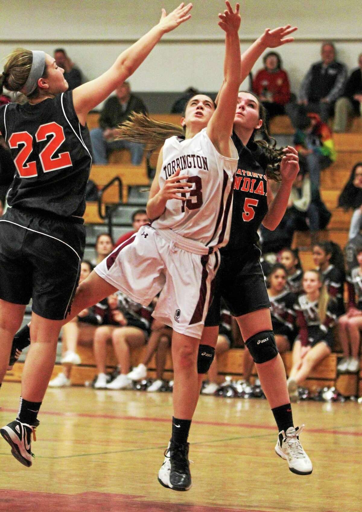 Torrington's Brie Pergola puts up a layup in the Red Raiders' come from behind 40-39 win over Watertown.