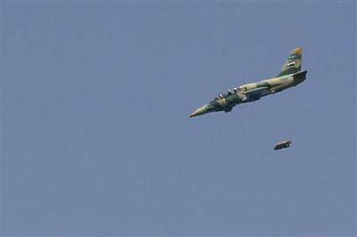 A Syrian Air Force fighter jet launches missiles at El Edaa district in Syria's northwestern city of Aleppo September 1.