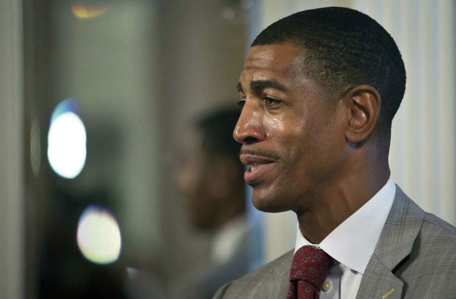 UConn men's basketball coach Kevin Ollie speaks during an interview at the American Athletic Conference media day on Wednesday in New York. Photo: Bebeto Matthews — The Associated Press  / AP
