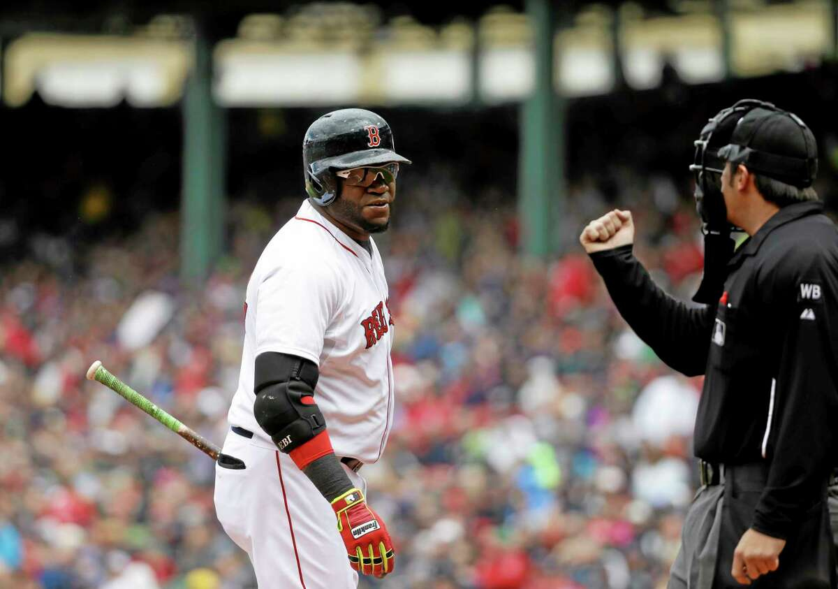 David Ortiz, left, looks toward home plate umpire umpire Mark Ripperger, right, after striking out in the first inning Sunday against the A's.