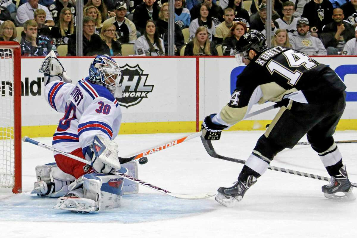 New York Rangers goalie Henrik Lundqvist can't stop a shot from the point by the Penguins' Kris Letang in the second period Sunday night.
