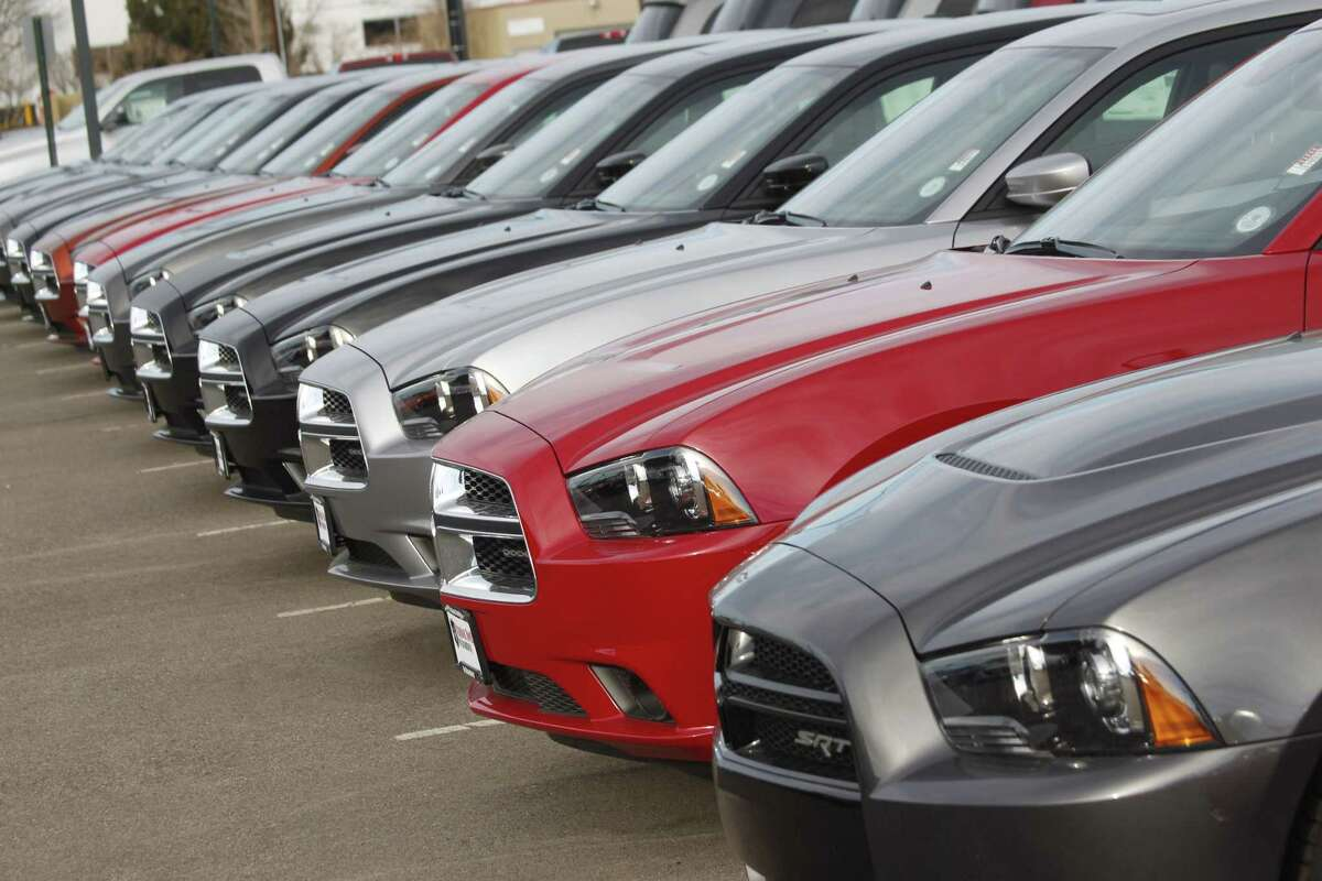 A line of unsold 2013 Chargers sits at a Dodge dealership in Littleton, Colo.