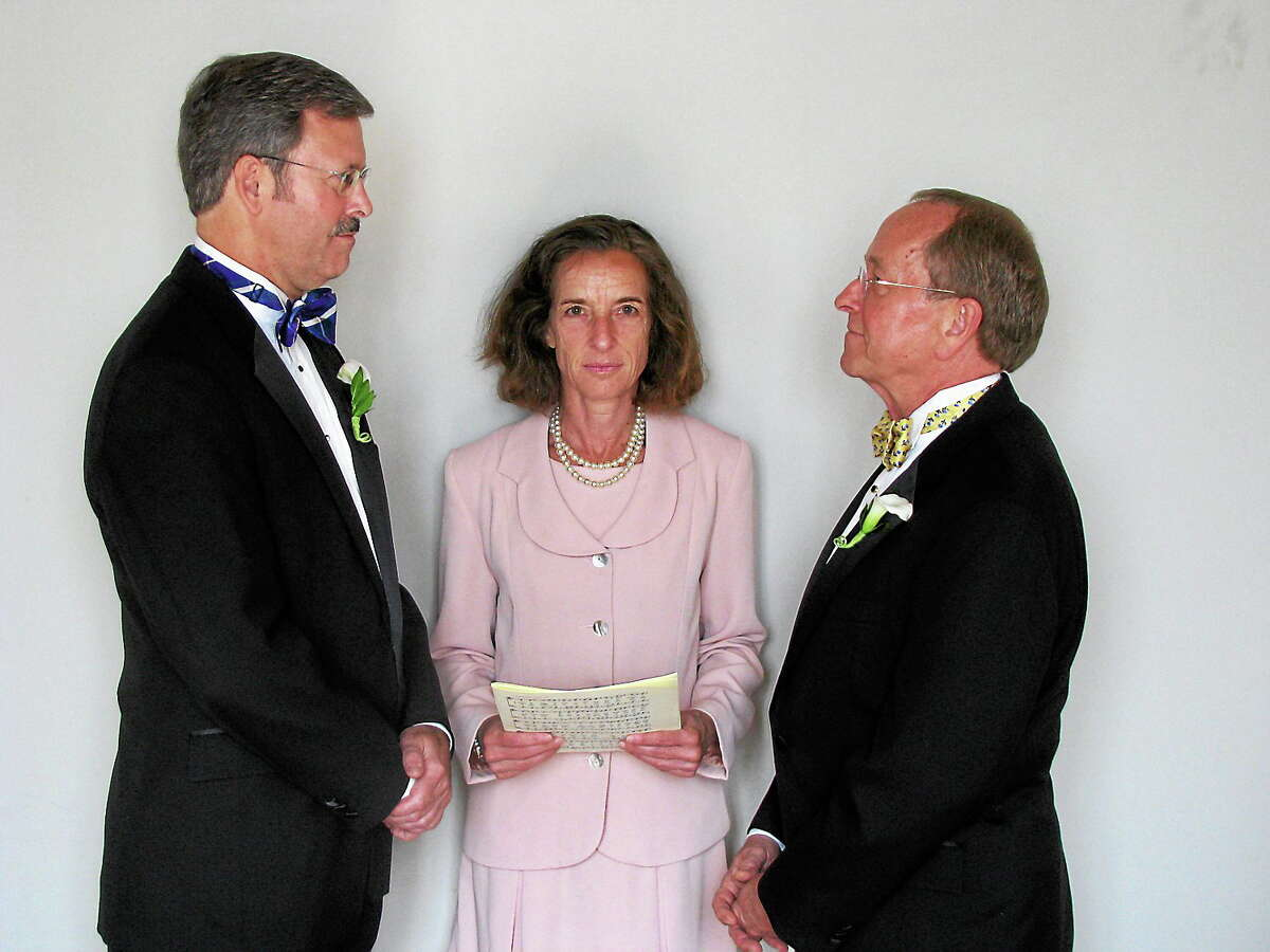 Mark Andrew, left, and Bishop V. Gene Robinson are shown during their private civil union ceremony performed by Ronna Wise in Concord, N.H. on June 7, 2008.