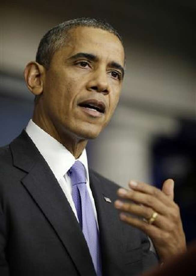 President Barack Obama makes a statement to reporters in the Brady Press Briefing Room at the White House after Senate lawmakers reached a bipartisan deal to avoid default and reopen the government. (AP Photo/Pablo Martinez Monsivais) Photo: AP / AP