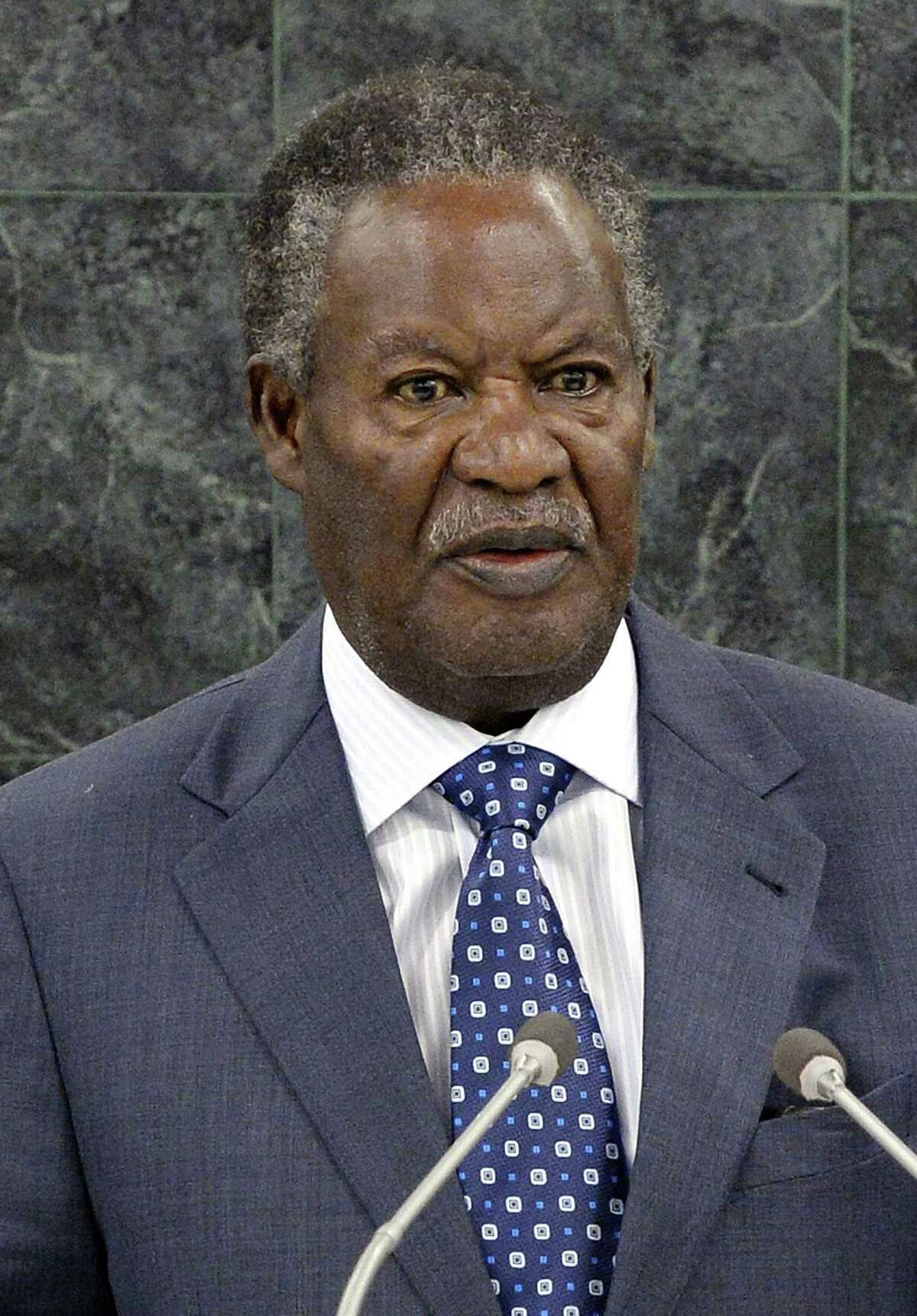 FILE - In this Sept. 24, 2013 file photo, Zambian President Michael Sata speaks during the general debate of the 68th session of the United Nations General Assembly at United Nations headquarters. Sata died Tuesday, Oct. 28, 2014 after an illness, the Zambian government said Wednesday, Oct. 29. The Cabinet held a meeting to discuss a political transition in the southern African nation in the wake of the president's death. He was 77. (AP Photo/Justin Lane, Pool, File)