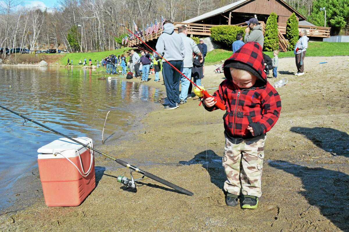 Wyatt Lentini, who will be two in June, took part (with a lot of assistance) in the Elks Lodge's 44th annual children's fishing derby Sunday. John Berry - The Register Citizen