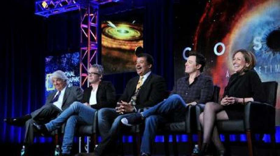 """Executive producer, from left, Mitchell Cannold, executive producer Brannon Braga, host Neil DeGrasse Tyson, executive producer Seth MacFarlane, and writer Ann Druyan participate on a panel for """"Cosmos"""" at the FOX Winter 2014 TCA, on Monday, Jan. 13, 2014, at the Langham Hotel in Pasadena, Calif."""