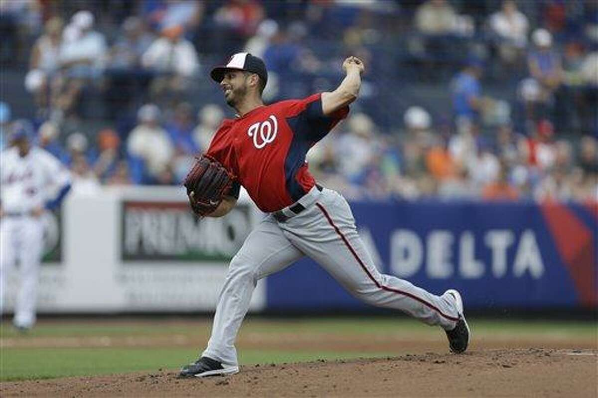 Washington Nationals starting pitcher Gio Gonzalez throws during the first inning of an exhibition spring training baseball game against the New York Mets Saturday, March 23, 2013, in Port St. Lucie, Fla. (AP Photo/Jeff Roberson)