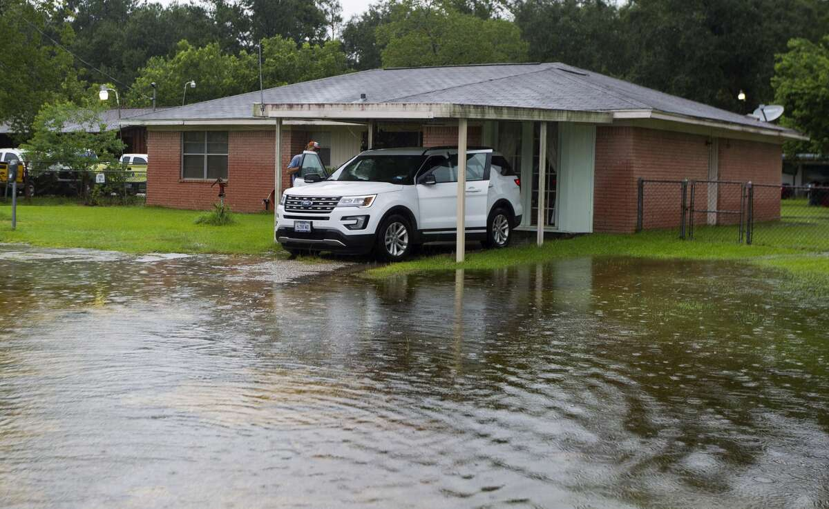 Harold Jones loads items into his car as he and his family evacuate their home on East Hammond Drive to escape flooding from Tropical Storm Harvey, Sunday, Aug. 27, 2017, in New Caney.