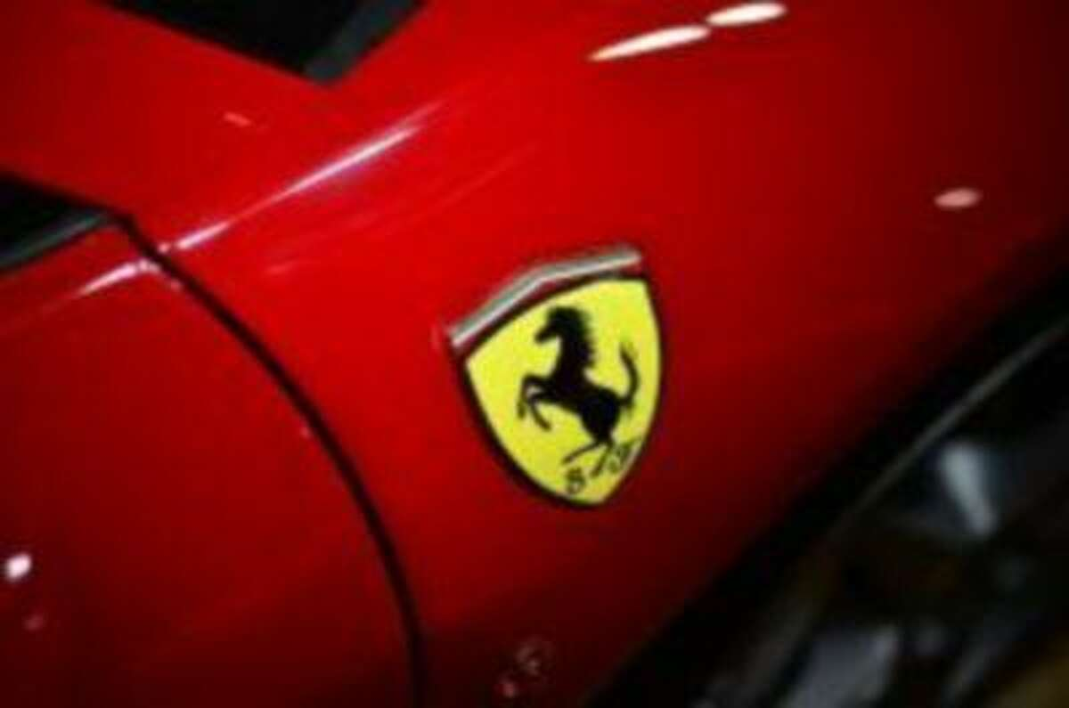 Ferrari is one of nine car companies to confirm that it will be integrating Apple's iPhone operating system within its cars before the end of 2014. (AFP Photo/Gabriel Bouys)