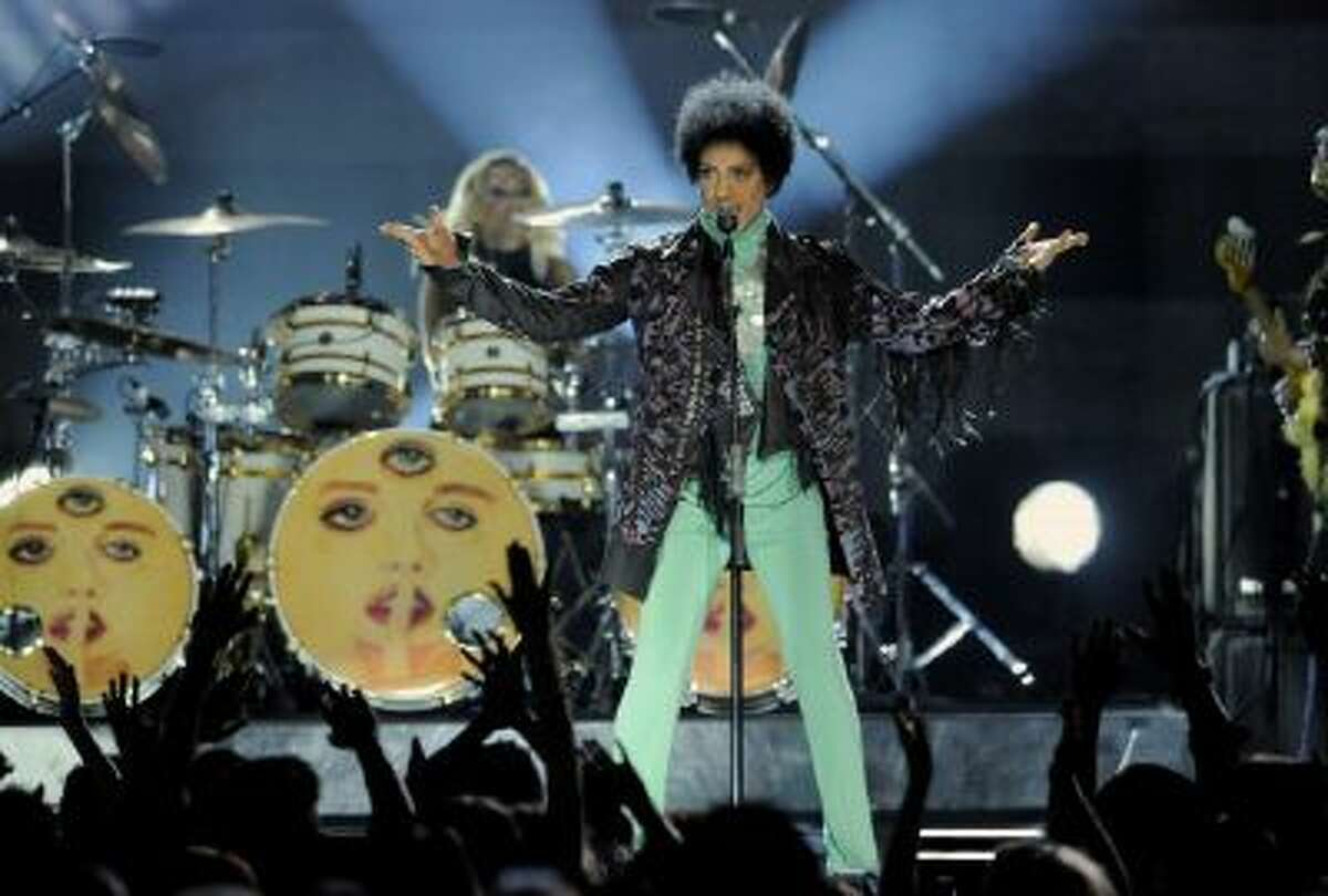 """In this May 19, 2013 file photo, Prince performs at the Billboard Music Awards at the MGM Grand Garden Arena, in Las Vegas. Fox's post-Super Bowl party will include Prince making a guest appearance on the comedy """"New Girl."""""""