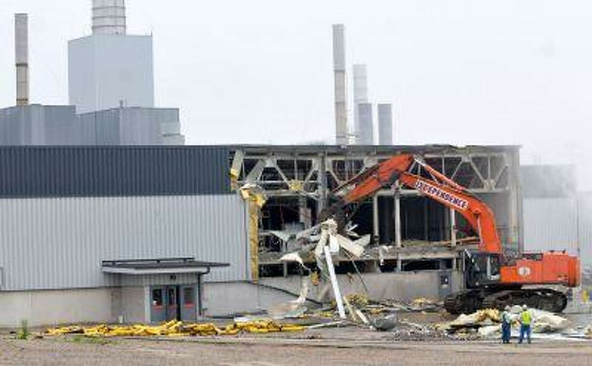 An excavator rips off the metal facade of the paint shop building as demolition of the Ford Twin Cities Assembly Plant began in the Highland Park neighborhood of St. Paul, Minn. on Monday June 10, 2013. The teardown of the entire Ford campus is tentatively scheduled to conclude in 2015, but land restoration could stretch into 2018. (AP Photo/Pioneer Press, John Doman)
