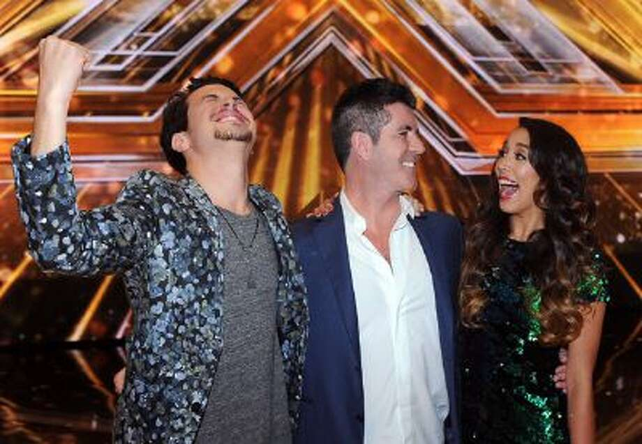 Simon Cowell and last season's winners, Alex & Sierra, during 'The X Factor' finale.