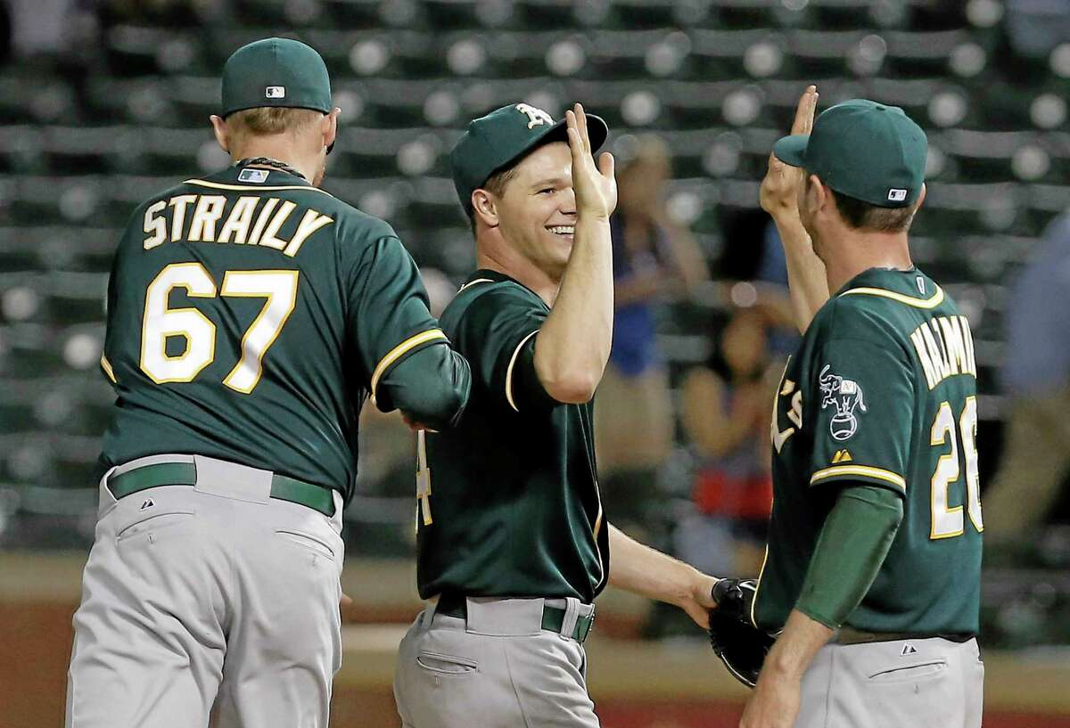 Starter Sonny Gray, center, has the Oakland Athletics at No. 3 in the latest Register MLB Rankings.