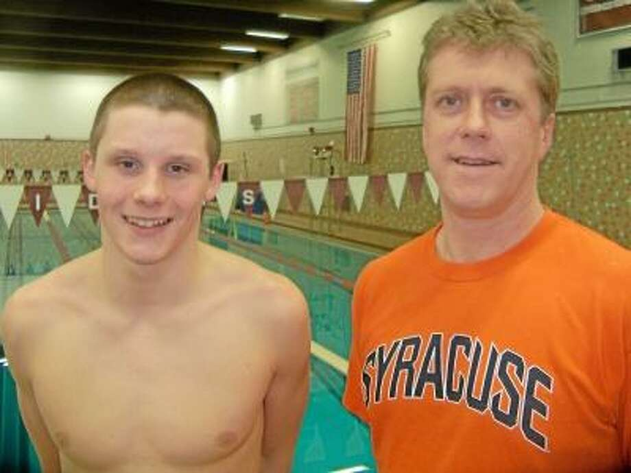 Torrington High School sophomore Matt Traub (left) stands with his new Lasers coach, David Steel, at the Northwest Connecticut YMCA's Torrington pool. Traub will compete in three events at the YMCA Nationals next week. Peter Wallace/Register Citizen