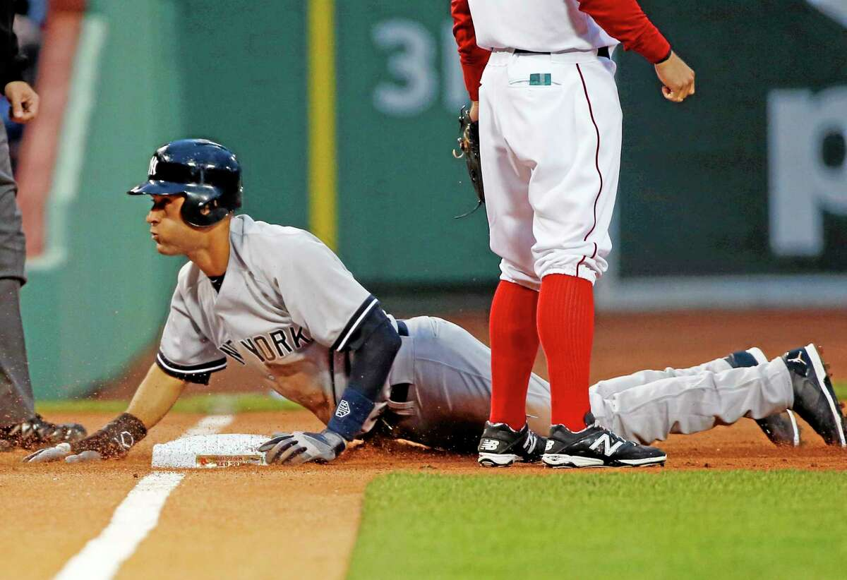 Derek Jeter slides into third base during an April 22 game against the Red Sox in Boston.