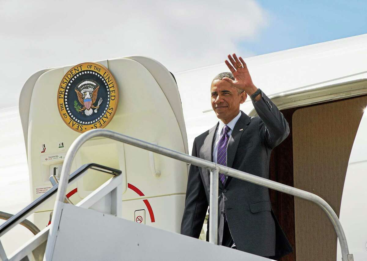 President Barack Obama waves upon his arrival at Westchester County Airport in White Plains, N.Y., Friday, Aug. 29, 2014.