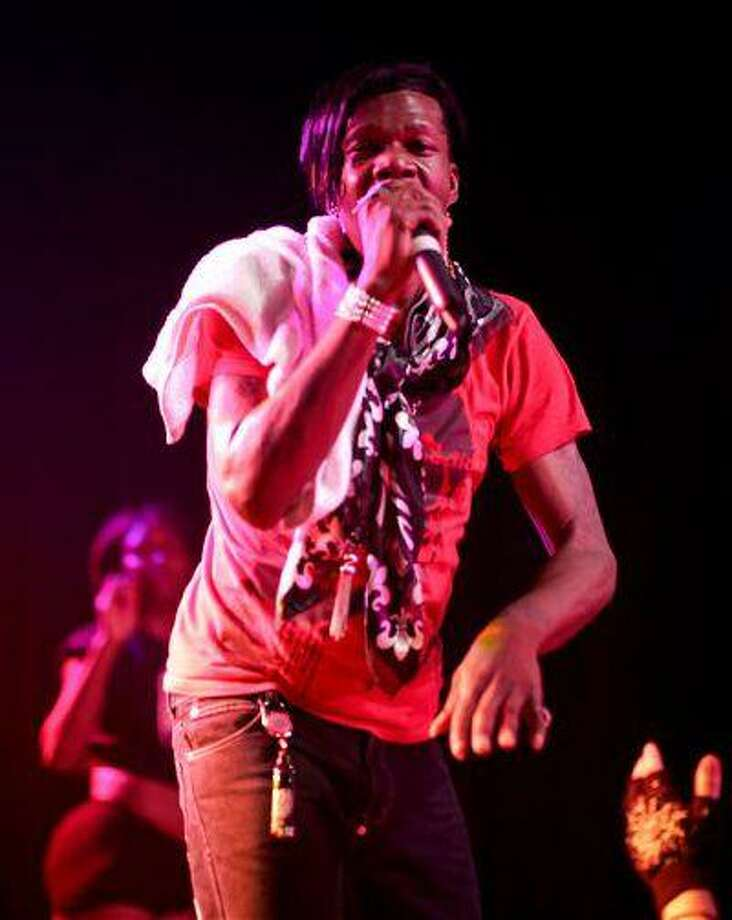 """This 2012 image released by Ballin PR shows Big Freedia, whose real name is Freddie Ross, performing at The Mezzanine in San Francisco. The openly gay performer has landed his own show on the Fuse television network. """"Big Freedia: Queen of Bounce will focus on Ross and the New Orleans music scene known as """"bounce"""" _ a fusion of hip-hop and quick, repetitive dance beats with heavy bass. Bounce music often includes call-and-response vocals, a nod to early rap and New Orleans Mardi Gras Indian roots music. Big Freedia is one of the few bounce artists with international exposure, having toured Europe, Australia and other countries as well as most of the U.S. The eight-episode series premieres Sept. 18. (AP Photo/Ballin PR, Beto Lopez ) Photo: AP / Ballin PR"""