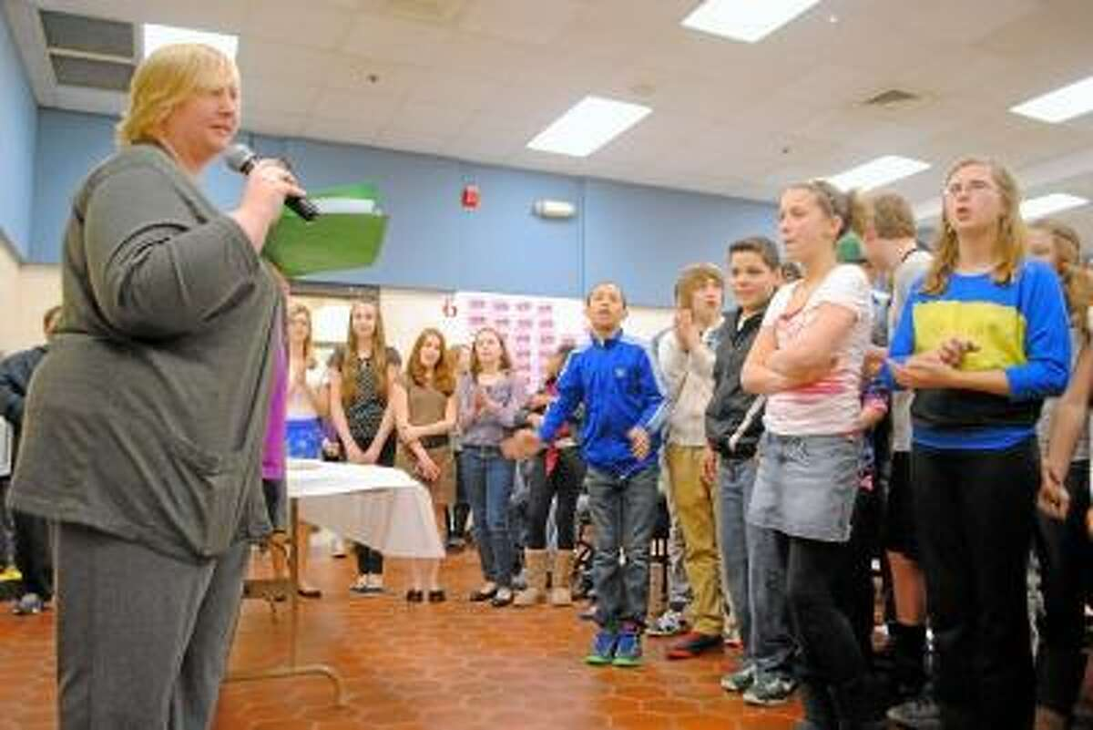 Jessica Glenza/RegisterCitizen -- Torrington Middle School teacher Tricia Dawson, in charge of more than 90 Invention Convention projects, announces 10 winners from the Silver team.