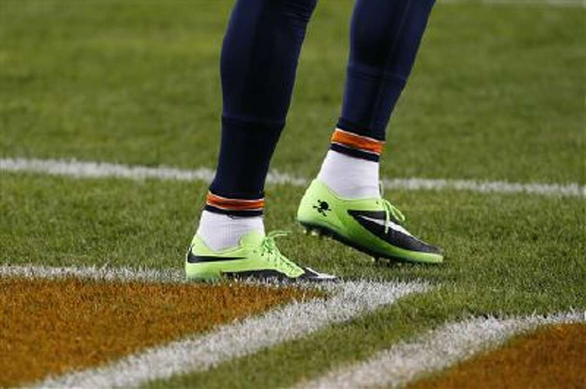 Chicago Bears wide receiver Brandon Marshall's shoes are seen as he warms up before a game against the New York Giants, Thursday, Oct. 10, 2013, in Chicago. Marshall plans to auction off the footwear and donate the proceeds to a charity supporting mental health awareness.