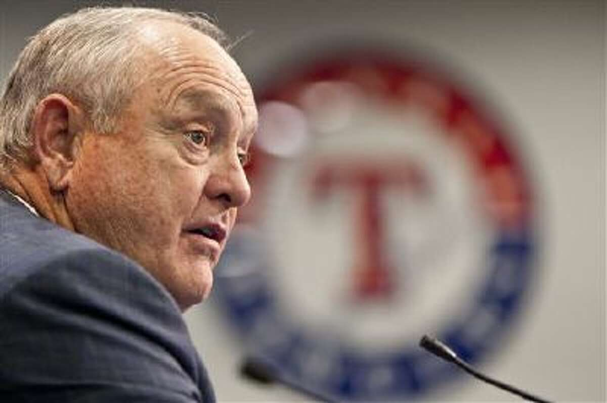 In this Jan. 18, 2012, file photo, Texas Rangers CEO and President Nolan Ryan speaks to reporters during a news conference in Arlington, Texas. Ryan announced in a statement on Thursday, Oct. 17, 2013, that he hs retiring after six years of serving as CEO of the Rangers. The Hall of Fame pitcher became the 10th president of the Rangers in February 2008 and became chief executive officer three years later.