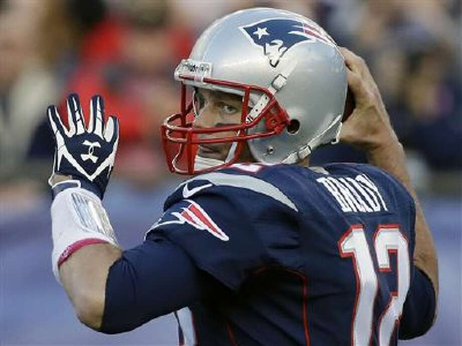 New England Patriots quarterback Tom Brady looks for a receiver in the first half of an NFL football game against the New Orleans Saints, Sunday, Oct. 13, 2013, in Foxborough, Mass. Photo: AP / AP