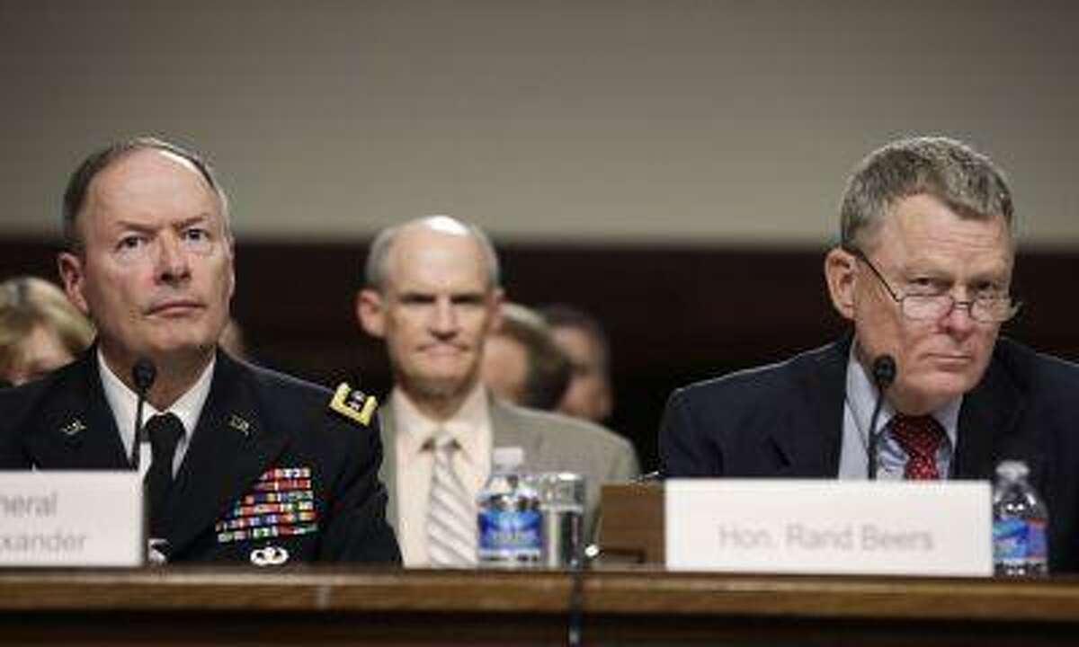 General Keith Alexander, left, commander of the U.S. Cyber Command, director of the National Security Agency and chief of the Central Security Service, and Rand Beers, acting deputy secretary of the Department of Homeland Security, testify before the Senate Appropriations Committee hearing on Cybersecurity: Preparing for and Responding to the Enduring Threat, on Capitol Hill in Washington June 12, 2013.