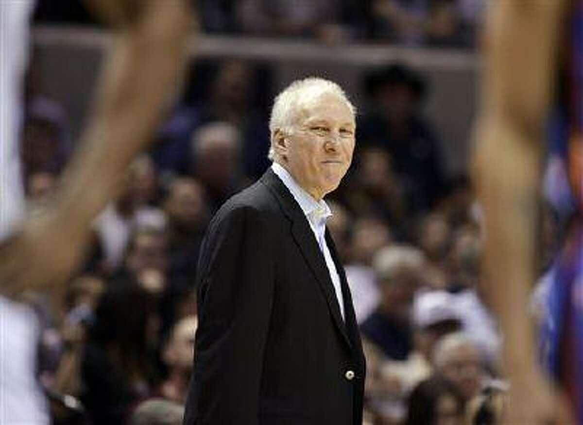 San Antonio Spurs head coach Gregg Popovich smirks during the second half of an NBA basketball game against the Oklahoma City Thunder, March 11, 2013, in San Antonio.