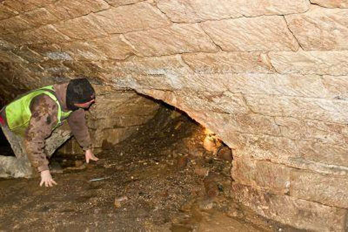 An Amherst, Ohio, city worker checks out a passage in the underground chamber discovered by workers last week.