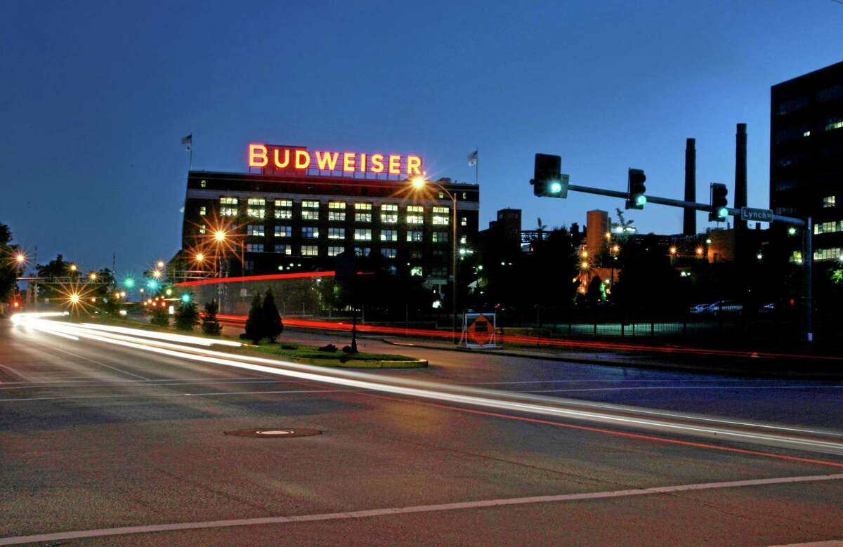 In this July 13, 2008, photo cars move near the Anheuser-Busch St. Louis brewery.