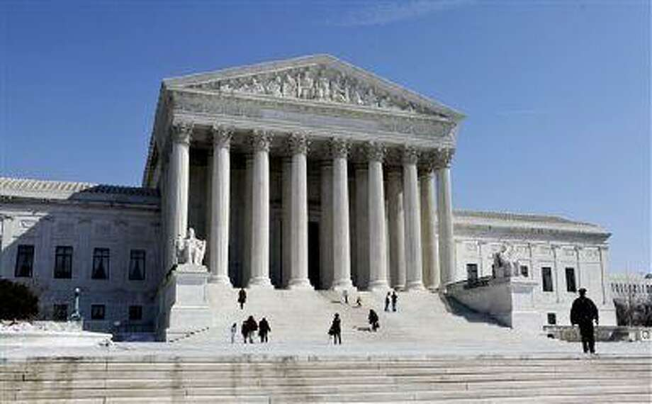 The Supreme Court Building is seen, Thursday, March 5, 2009, on Capitol Hill in Washington. Photo: AP / AP
