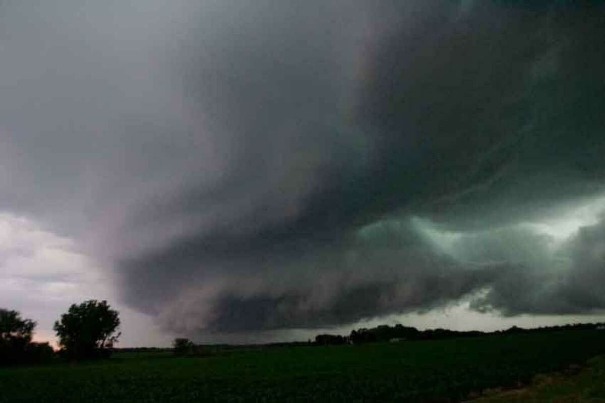 A wall cloud, containing a reported funnel cloud, passes over the Wanatah, Ind. area as a line of severe storm moves through the area Wednesday June 12, 2013. (AP Photo/The LaPorte Herald-Argus, Bob Wellinski)