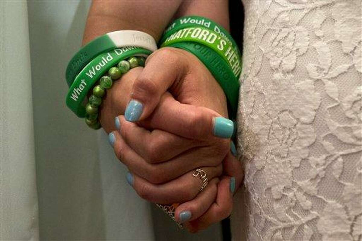 Jillian Soto, left, and Carlee Soto, sisters of Newtown, Conn. shooting victim Victoria Soto, hold hands during a news conference on Capitol Hill in Washington, Thursday, June 13, 2013, with member of Congress and Newtown families on the six month anniversary of the Newtown shootings,. (AP Photo/Jacquelyn Martin)
