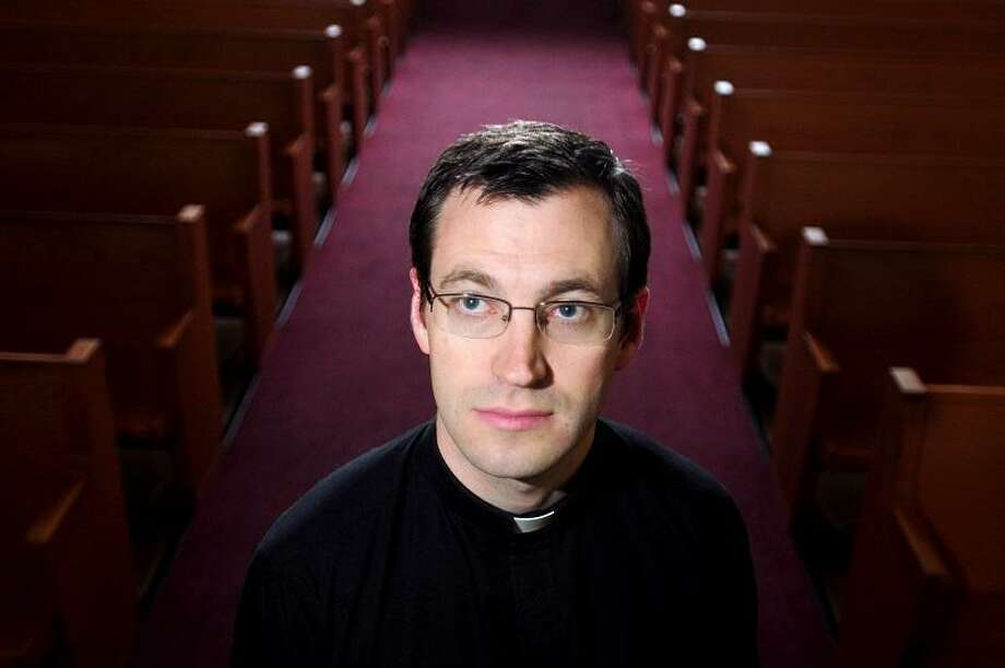 Arnold Gold Ñ RegisterPastor Rob Morris is photographed at Christ the King Lutheran Church in Newtown on 6/12/2013.