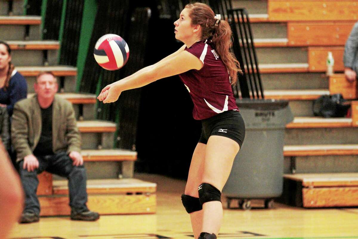 Torrington's Carly Ruzbasan sets a ball during the Red Raiders' 3-2 loss to Woodland Tuesday.