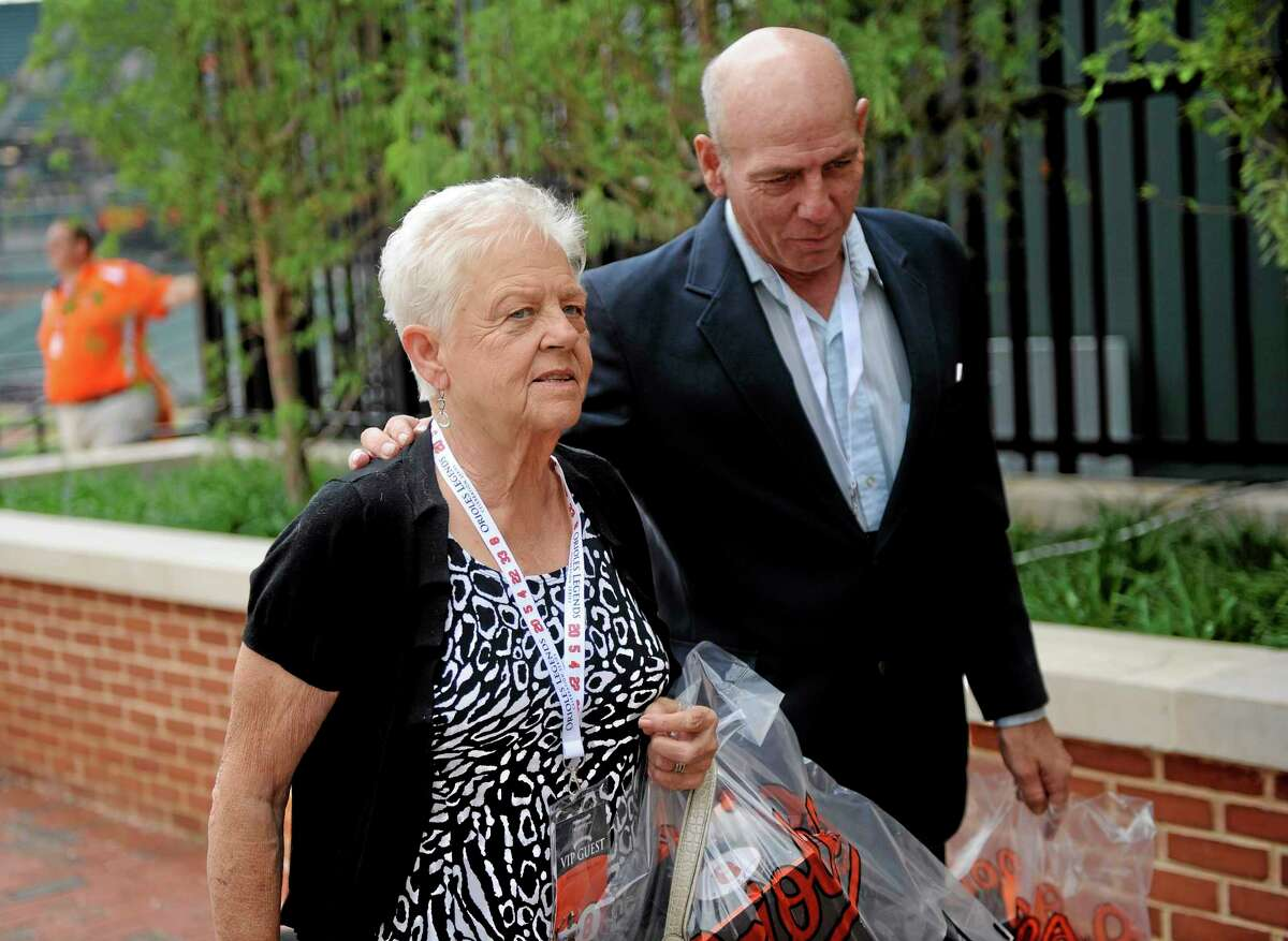 In a Sept. 6, 2012 file photo, Vi Ripken, mother of former Orioles legend and Hall of Famer Cal Ripken Jr., arrives at a ceremony to unveil his statue in Baltimore. On Wednesday, police charged Jesse Brown, 33, with trying to carjack the 75-year-old on Tuesday in a bank parking lot in Aberdeen, Md. Ripken wasn't hurt and went into the bank to report the crime, Aberdeen police spokesman Lt. Frederick Budnick said. Officers arrested Bowen about two hours later. On July 24, 2012, Ripken was taken from her Aberdeen home at gunpoint and returned unharmed 24 hours later. At that time, police released a sketch, photographs and a surveillance video that were believed to show a potential suspect. Budnick said Tuesday night that the two crimes do not appear to be related.