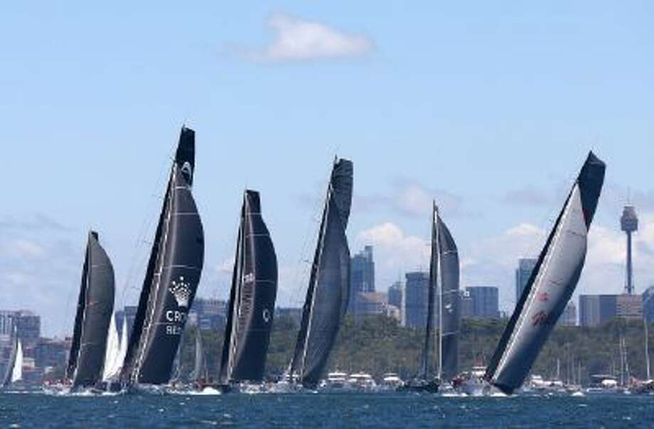 Some of the bigger boats lead the field in Sydney Harbour just after the start of the Sydney Hobart yacht race Thursday, Dec. 26, 2013.
