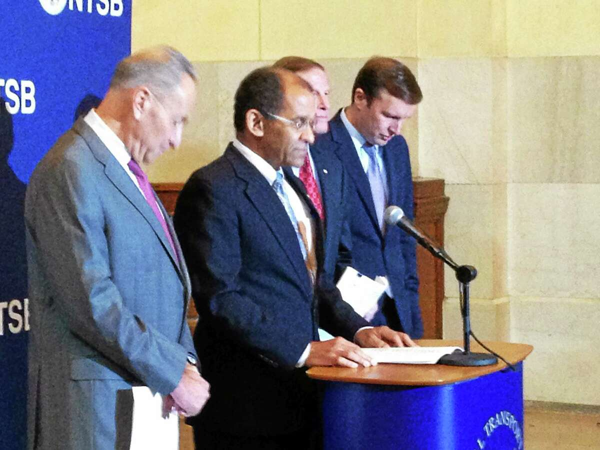 National Transportation Safety Board acting Chairman Christopher Hart, second from left, at a press conference Tuesday announcing the agency's investigations of five Metro-North accidents since 2013. With him, from left, are U.S. Sens. Charles Schumer, D-N.Y., Richard Blumenthal, D-Conn., and Christopher Murphy, D-Conn.