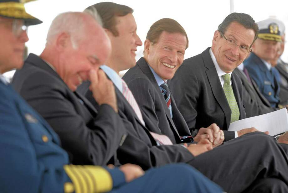 Connecticut Governor Dannel P. Malloy, far right, does some good humored ribbing of Congressman Joe Courtney, left, while Connecticut Senators Chris Murphy and Richard Blumenthal laugh along after Congressman Courtney's late arrival to the ground breaking ceremony for the National Coast Guard Museum at the City Pier Stage on Waterfront Park in New London, Conn., Friday May 2, 2014.  (AP Photo/The Day, Tim Cook) Photo: AP / The Day